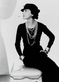 4e7232581a1 The timeless style of Coco Chanel in her little black dress adorned with  strands pearls of various lengths and her favorite Verdura cuffs