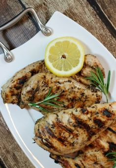 This Lemon Pepper Iced Tea Chicken uses my absolute favorite marinade. Tart, sweet, peppery, garlicky – I can't get enough! Each chicken breast is only 206 calories or 5 Weight Watchers points! www.emilybites.com