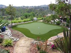 """Don't ever tell your husband """"Yeah, a putting green would be cool in the backyard."""""""