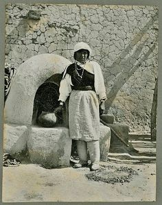 Isleta woman next to a beehive oven at Isleta Pueblo in New Mexico - 1907