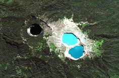 The three crater lakes of Kelimutu volcano in Indonesia are seen in a satellite photo. The three lakes periodically vary in color independent of each other. Geologists believe the three lakes change color as a result of chemical reactions between the minerals in the lakes and volcanic gas.