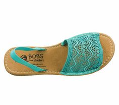 How cute are these strappy sandals in turquoise? AND we donate shoes to children in need when you purchase!