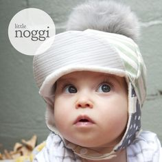 *This listing is for Pom Pom added.'Dapple' MERAKI is a new release gender neutral WINTER Little Noggi hat design. Limited edition of 50 only.The fabric palette is dramatic in its print appearance with a muted neutral colour way, perfectly suited to the fashionably modern little boy or girl.Quality fabrics have been meticulously selected with aesthetic, environment and function in mind.  The 'Dapple' MERAKI palette is centred around beautiful sage fabric by independent S...