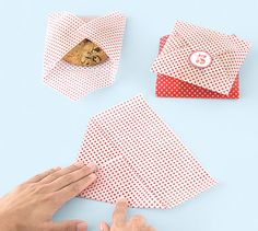 Cookie Packaging - Wrapping cookies in colorful wax paper and then sealing it with a sticker.