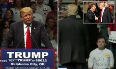 Donald Trump stares down a protester wearing a KKK shirt in Oklahoma | Daily Mail Online