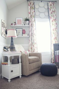 Love the cozy nook, high curtains, and pom poms.