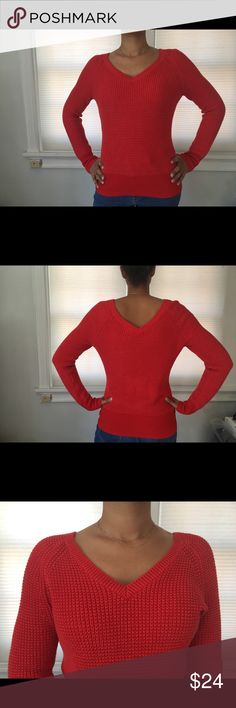 Knit V-Neck Sweater Pre-loved in good condition. Orangey red knit sweater by Calvin Klein  Size medium, modeled on women's size 4/6. Small mark on wrist (shown in last photo), but in otherwise EUC. 83% cotton, 13% nylon Calvin Klein Sweaters V-Necks