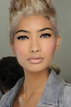 Light pink cheeks and lips with black eyeliner PLUS a hot edgy hair cut and color!