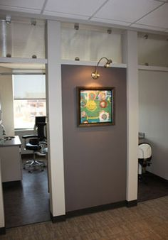 Art is put on display in this Dental Office Design.