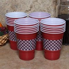 Easy way to dress up the Solo cup! This Bama fan used duct tape, I might make a little Starbucks-style sleeve with some fun scrapbook paper