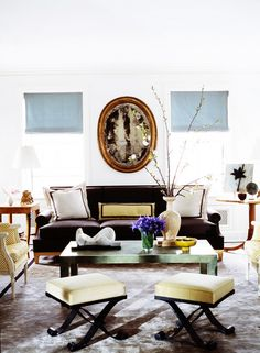 Meet The Only Table Style You'll Ever Need// layered living room with antique mirror, Parsons coffee table, and pair of stools