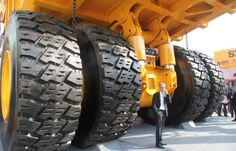 That tires are twice as tall as a human.
