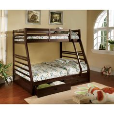 Make the most of a bedroom's space with this twin-over-full bunk bed. Constructed of solid wood with a sturdy access ladder and contemporary slat design, this bed has a dark walnut finish and two drawers for additional space-saving benefits.