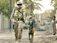 MWD and handler....the Belgian Malinois is a popular breed used. What a beautiful dog.