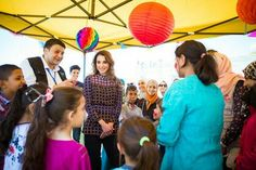 Queen Rania Al Abdullah meets with volunteers from the Mujaddidun Society for Charity and Development in the recreation grounds of Iraq Al Amir Secondary School for boys, in Amman, Jordan on June 12, 2016. Queen of Jordan was briefed on several of the Society's programs that aim to promote volunteer work among youth in Jordan during the holy month of Ramadan.
