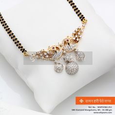 The knot represents women's obedience to her husband Diamond Mangalsutra, Gold Mangalsutra Designs, Gold Earrings Designs, Necklace Designs, Diamond Jewellery, Coral Jewelry, Wedding Jewelry, Beaded Jewelry, Beautiful Earrings