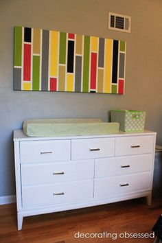 green yellow argyle wall baby girl nursery changing table with custom wall art