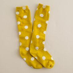 mustard-colored polka dot socks.