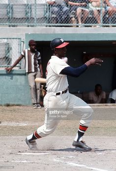 Rico Carty #7 of the Milwaukee Braves bats during an Major League Baseball game circa 1965. Carty played for the Braves from 1963-72.