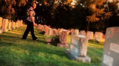 Mourning Woman Visits Grave in Cemetery Stock Video Footage - VideoBlocks