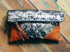 """Rose gold scattered sequins with leather clutch - beautiful as an accent clutch, a travel companion, purse or make-up bag.~ rose gold sequins ~ distressed Italian tan leather bottom corners ~ measures 10"""" x 9"""" ~ 8"""" metal YKK zipper ~ distressed leather zipper pull with stud detail with milagro charm ~ lined with natural cottonScout"""