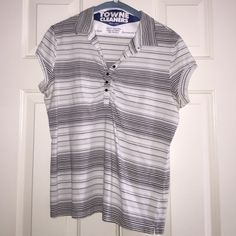 ***SALE***  Apostrophe Ladies Top. Apostrophe Ladies Top.   Stretch.  Black & White stripe with cute button & ruche at the bust.  Size M Apostrophe Tops