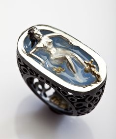 "Selda Okutan Jewelry, ""Relax Ring"", The top and flower are 14k Gold and the rest is oxidized sterling silver. Transparent light blue Enamel is utilized inside the bath."