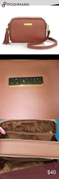 JOY & IMAN Leather Cognac Crossbody Bag NWOT JOY & IMAN Fashionably Functional RFID Leather Bag  Fashion and function come together in a stylish, safe and smart accessory you can take anywhere. This compact genuine leather crossbody, designed with 23 interior and 1 exterior pocket, eliminates your need to carry a wallet or cosmetic bag. Easy-access openings put everything right at your fingertips, while the main body's RFID protection safeguards your personal information. joy & iman Bags…