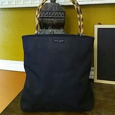 Kate Spade Nylon Bag Classic older style black nylon bag with wooden handles. Corners show some wear. Overall great bag with lots of life left. kate spade Bags Satchels