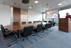 BDO large accounting firm office refurbishment. Presenting room with large screen. Comfortable boardroom table. Office design by Interaction.