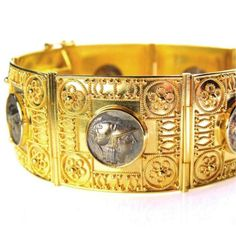 Damaskos Iraklion Athena Bracelet. 18k Gold, Rubies and Emeralds. Hand crafted detail by our jewelry designers makes the work stand out. Greek jewelry at www.athenas-treasures.com