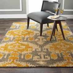 Gray and Gold Ikat  Brush Cut Jute Rug This over scaled Ikat pattern in watery shades of pewter gray and golden yellow over khaki cream is artistically rendered on natural jute. Rich in texture and plush underfoot, the brushed cut jute allows variations in color that create a sumptuous washed sheen over the rug. Hand knotted in India. 100% jute.