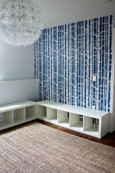 Seating/storage with Ikea Expedit shelving unit $59.99/each.  I'd like wanescotting on the walls and covered storage.  LOVE this, and an easy fix for storage limitations.