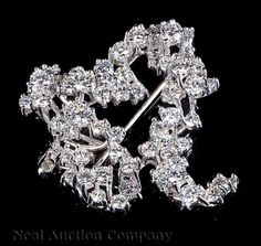 Platinum and Diamond Cluster Brooch, set with 66 round brilliant cut diamonds, VS1-VS2, color F-G, totaling approx. 3.5 cts