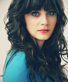 Curly hair with bangs looks extremely charming and feminine. Many women with natural curls still