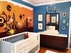 robot nursery. Blue and orange with clean simple layout, low key patterns and cool decal focus wall. #boy #room #decor