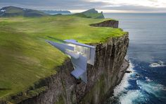 Incredibly compelling cliffside House by Visualizing Architecture tucked in land...  #cliffsidehomes #cliffsidehouses