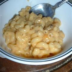 Simple Mac and Cheese Recipe - This creamy bake of macaroni and cheese is assembled with almost effortless ease by combining cooked macaroni with cream of mushroom soup, milk and shredded cheese. Pop it into a hot oven and get ready to eat! Crockpot Mac And Cheese, Creamy Macaroni And Cheese, Easy Mac And Cheese, Making Mac And Cheese, Macaroni N Cheese Recipe, Mac And Cheese Homemade, Cheese Recipes, Cooking Recipes, Mac Cheese