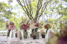 Table Decor with Curly Willow, Mixes of vintage styled flowers including Lace, Coffee Roses, Pink Sweet Avalanche Roses,  Lisianthiums, crysanthemums, Silver Brunia, Slangbos