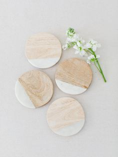 """This set of four coasters are made of beautiful Mango wood and marble materials making them a durable, practical, and beautiful addition to any room. Size: 4"""" Round Material: Marble & Mango Wood Each"""