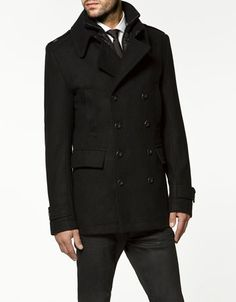 Three quarter length peacoat. The classic yet modern styling lends to casual and semi-casual attire