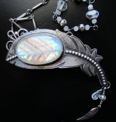 Sterling Silver, Rainbow Moonstone Feather Necklace by WildSoulStudio
