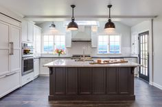 This open concept white farmhouse style kitchen with dark contrasting island is the heart of the home. Cabinetry and design by Kitchen Intuitions & construction by Kraftmaster Renovations. Indian Home Interior, Interior S, Interior Ideas, Farmhouse Style Kitchen, Modern Farmhouse Kitchens, White Farmhouse, Affordable Home Decor, Cheap Home Decor, Home Design