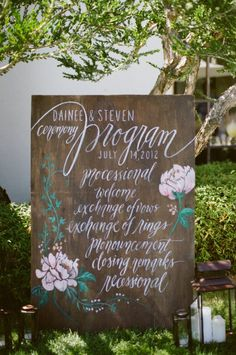 Ceremony program on wooden board (or chalkboard??) for all to see...saves money on buying individual programs and looks nicer!