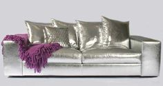 Shinny silver sofa...not for me, but a  definite conversation piece