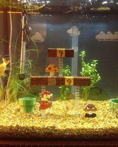 Super Mario Bros. aquarium fish tank. Notice, the decor is made from Legos. Yes, please. @Alex Jones Jones Hayden