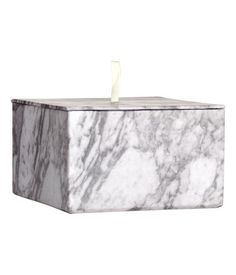 Cardboard storage box with a marbled pattern and a lid with a small handle of satin ribbon. Size 8x13.5 cm.