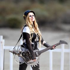 Avril Lavigne has some fun on day two of filming her music video with a saw blade electric guitar on the set of Rock N Roll in Palmdale, Los Angeles, CA, USA on July 26, 2013. The sexy blond rocker chased around what appeared to be a bear shark with a mad max style guitar with a saw blade on it. She laughed as she charged the man in costume and even fell to the ground as she slipped in the sand. Photo by GSI/ABACAPRESS.COM27/07/2013 - Los Angeles