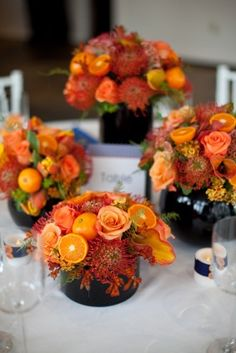 I love the oranges in these arrangements!