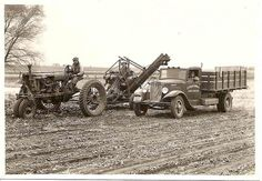 Vintage Harvesting photo of a farmall and International truck